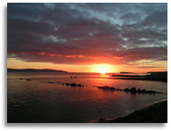 The sun setting over Galway Bay near Galway City in County Galway Ireland